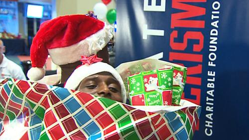 Kids Get Chance To 'Wrap-A-Pat' At 20th Annual Patriots Holiday Party