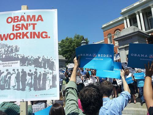 Romney Supporters Try To Upstage Obama Advisor At State House